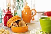 Apple chips in a ceramic pot