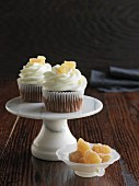 Chocolate cupcakes with candied ginger on a mini cake stand