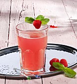 A glass of raspberry lemonade with ginger