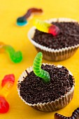 Two chocolate cupcakes decorated with jelly worms