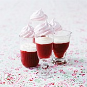 Strawberry shots with cream and meringues