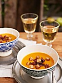 Apple and pumpkin soup with bacon and croutons