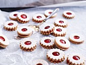 Jammy shortbread biscuits on baking paper