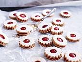 Jammy shortbread biscuits on baking paper