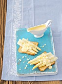Toast topped with white asparagus and Hollandaise sauce