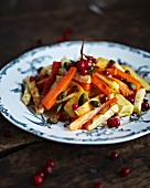 Marinated roasted root vegetables with pistachios and lingonberries