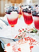 Rice dessert with strawberry jelly and blueberries for Christmas