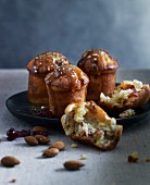 Christmas muffins with caramel sauce on a black plate