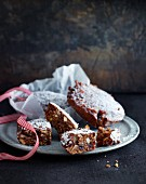 Panforte cakes with a ribbon on a grey plate