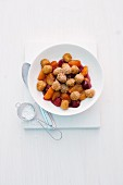 Sweet mini gnocci with raspberries and apricots