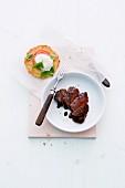 Steak with balsamic cream and potato cakes