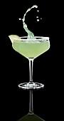 A splashing margarita in a glass
