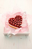 A heart-shaped raspberry tart with vanilla-quark cream