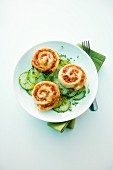 Pizza whirls on a cucumber salad