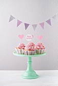 Cupcakes with pink buttercream and bunting for a birthday party