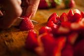 Strawberries being sliced