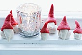 Festive arrangement of marzipan gnomes