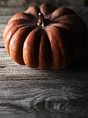 A pumpkin on a wooden surface