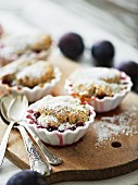 Plum and poppyseed crumble cake with icing sugar