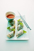 Rice paper rolls filled with minced meat and served with a chilli dip
