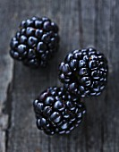 Blackberries on a wooden surface
