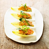 Chicory boats with guacamole, salmon salad and wakame
