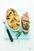 Pork fillet with a potato and mushroom gratin