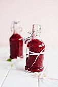 Two bottles of berry smoothie