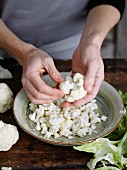 Cauliflower being prepared
