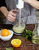 Salad dressing being whisked with a hand mixer