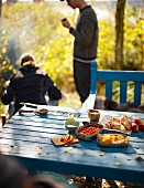 An autumnal picnic in a garden