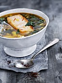 Fish soup with spinach and white beans