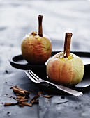 Stuffed baked apples with cinnamon sticks