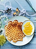 Sponge cake waffles with mango fillets
