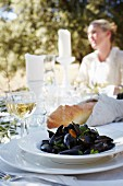 Mussels steamed in white wine served with baguette