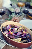 Aubergines with lemons and red onions