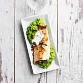 Salmon trout strips with mushy peas