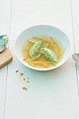 Herb and quark dumplings in vegetable stock