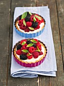 Mixed berry tarts with vanilla cream