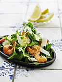 A rocket salad with prawns and Parmesan cheese