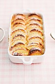 Scheiterhaufen (bread bake with apples, cinnamon, raisins and almonds) with icing sugar