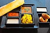 Vegetarian Masala Dosa (curried potatoes, dosa, lentils, raita and gulab jamun, India)