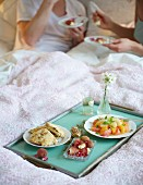 Breakfast in bed with citrus salad and sunflower seed and cheese scones