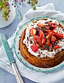 Strawberry cake with cream and grated chocolate