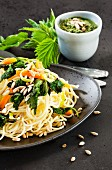 Spaghetti with stinging nettles, carrots and sunflower seeds