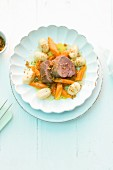 Veal fillet with braised orange-carrots, gnocchi and spiced crumbs