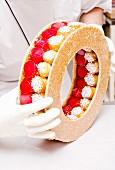 A confectioner creating a pièce montée wedding cake with profiteroles (France)