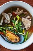 Spicy Tom Yam soup with seafood (Thailand)
