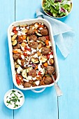 Buckwheat bake with vegetables and meatballs