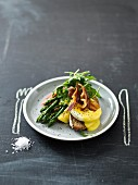 A poached egg, asparagus, bacon and Hollandaise sauce sandwich